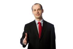 Geschäftsmann, der einen Händedruck anbietet Stockbilder