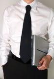Geschäftsmann, der einen Laptop anhält Lizenzfreies Stockfoto