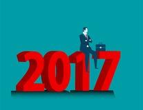 Geschäftsmann, der Erfolg dem Sitzen über Nr. 2017 betrachtet Lizenzfreie Stockfotografie