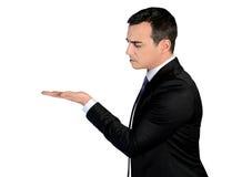 Geschäftsmann, der etwas misstrauisch darstellt Lizenzfreie Stockfotos