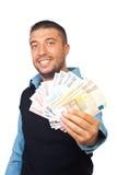 Geschäftsmann, der Eurobanknoten gibt Stockfotos