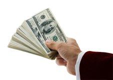 Geschäftsmann, der fächerförmige Dollar anhält Stockfotos