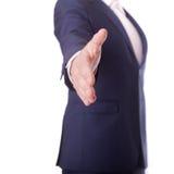 Geschäftsmann, der für Händedruck anbietet Stockbild