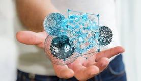 Geschäftsmann, der fliegenden abstrakten Bereich mit glänzendem Würfel 3D bezüglich hält Stockbild