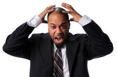 Geschäftsmann, der Frustration ausdrückt stockfotografie