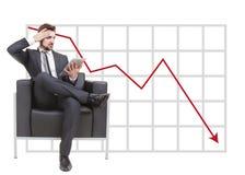 Geschäftsmann in der Gefahr auf grafischem Hintergrund Lizenzfreie Stockfotografie