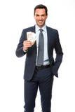 Geschäftsmann, der Geld lächelt und hält Stockfotografie