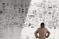 Geschäftsmann, der Geschäft Konzept und strategey schaut Stockbilder