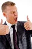Geschäftsmann, der Gesichtsausdrücke blinzelt und zeigt Lizenzfreie Stockbilder