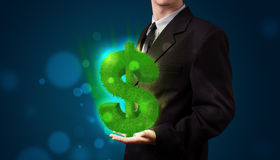 Geschäftsmann, der grünen glühenden Dollar darstellt Lizenzfreie Stockbilder