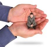 Geschäftsmann in der Hand eingeschlossen Stockbild