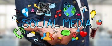 Geschäftsmann, der Hand gezeichnete Social Media-Darstellung hält Stockfotografie
