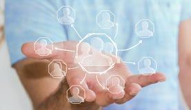 Geschäftsmann, der Hand gezeichnetes Soziales Netz hält Lizenzfreies Stockfoto
