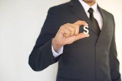 Geschäftsmann, der Hand hält Stockfoto