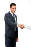Geschäftsmann, der Hand lächelt und rüttelt Stockfotografie