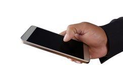 Geschäftsmann, der Handy lokalisiert auf weißem Hintergrund hält Stockfotos