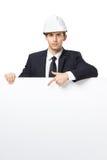 Geschäftsmann, der Handzeichen auf copyspace zeigt lizenzfreies stockfoto