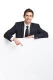 Geschäftsmann, der Handzeichen auf Kopienraum zeigt lizenzfreies stockfoto