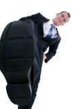 Geschäftsmann, der heraus die Konkurrenz stampft Lizenzfreies Stockbild