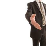 Geschäftsmann, der heraus seine Hand mit Exemplarplatz anhält Lizenzfreie Stockbilder