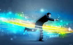 Geschäftsmann, der in High-Teches Wellenkonzept läuft Stockbilder