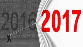 Geschäftsmann, der hinunter den Vorhang 2017 bedeckt altes Ziegelstein wa 2016 zieht lizenzfreie stockfotografie