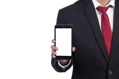 Geschäftsmann, der im Handsmartphone hält Stockfotos