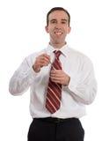 Geschäftsmann, der Joghurt isst Stockfoto