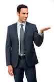 Geschäftsmann in der Klage mit dem angehobenen Arm Stockbild