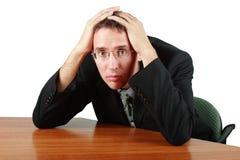 Geschäftsmann in der Mühe Lizenzfreie Stockfotos