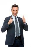 Geschäftsmann, der mit den Daumen oben lächelt Lizenzfreies Stockbild