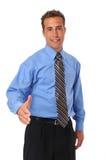 Geschäftsmann, der mit der entfalteten Hand begrüßt Stockbild
