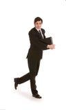 Geschäftsmann, der mit einem Ordner geht Lizenzfreies Stockbild