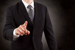 Geschäftsmann, der mit seinem Finger zeigt Stockfotografie