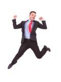 Geschäftsmann, der mit seinen Händen in der Luft springt Lizenzfreie Stockbilder