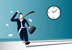 Geschäftsmann, der mit Uhr auf Hintergrund läuft Lizenzfreie Stockbilder