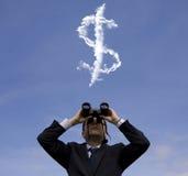 Geschäftsmann, der nach Vermögen sucht Stockfoto