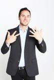 Geschäftsmann, der Nr. acht zählt Stockfotografie