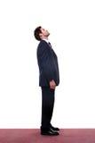 Geschäftsmann, der oben schaut Stockbild