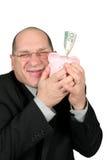 Geschäftsmann, der Piggy Querneigung anhält Stockbild