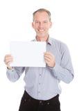 Geschäftsmann, der Plakat hält Lizenzfreie Stockbilder
