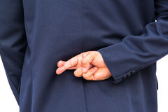 Geschäftsmann in der Rückseite mit den Fingern gekreuzt lizenzfreie stockfotos