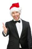 Geschäftsmann, der Santa Claus-Kappenhändedruckgesten trägt stockfotografie