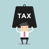 Geschäftsmann, der schwere Steuer trägt Lizenzfreie Stockfotos