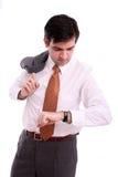Geschäftsmann, der seine Armbanduhr überprüft Lizenzfreie Stockfotografie