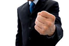 Geschäftsmann, der seine Faust des Erfolgs anhebt Stockbilder