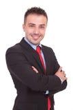Geschäftsmann, der seine Hände gekreuzt hält Lizenzfreie Stockbilder