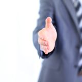 Geschäftsmann, der seine Hand gibt Lizenzfreie Stockbilder