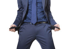 Geschäftsmann, der seine leeren Taschen zeigt Stockfoto