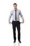 Geschäftsmann, der seine leeren Taschen zeigt Lizenzfreies Stockbild